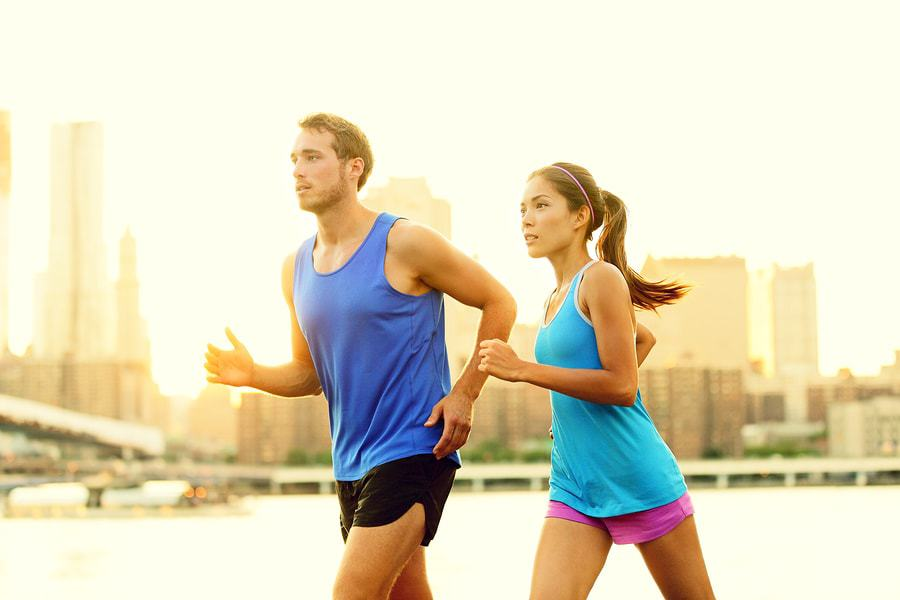 bigstock-City-running-couple-jogging-ou-45657916